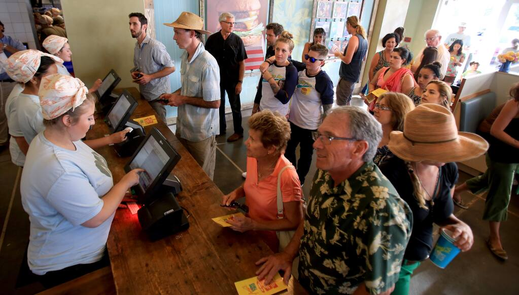 A line forms at Amy's Drive-Thru in Rohnert Park on the first day of business, Monday, July 20, 2015. (KENT PORTER/ PD)