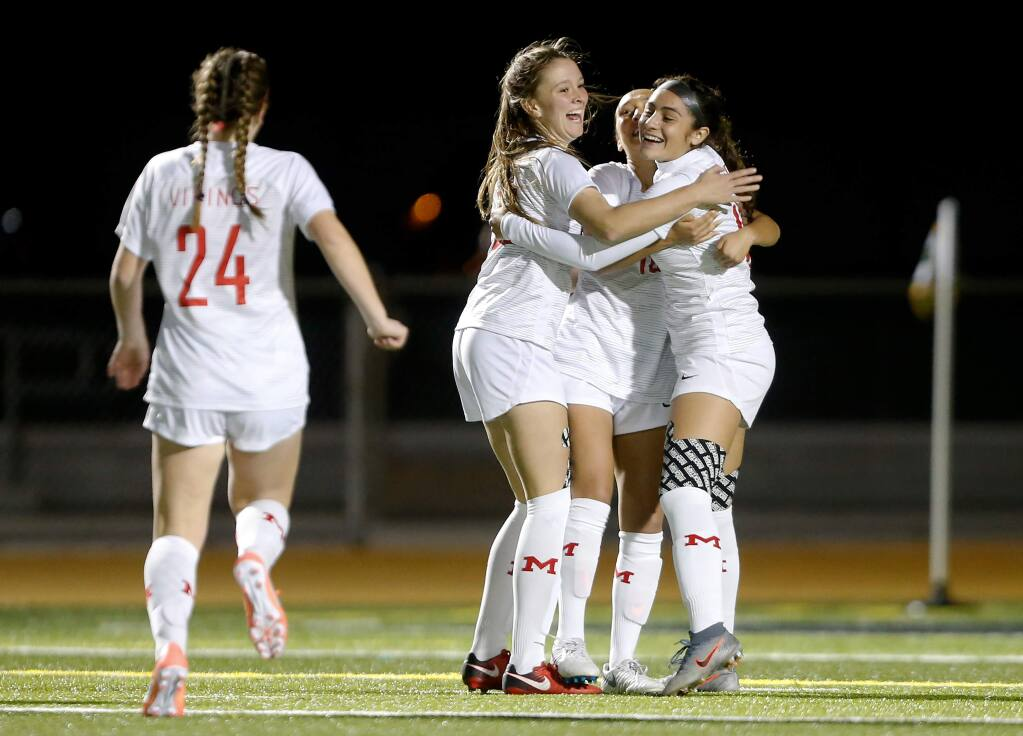 Montgomery's Paola Gomez (19), far right, Micky Rosenbaum (10), and Abria Brooker (23) celebrate after a Viking goal during the first half of a girls varsity soccer match between Montgomery and Maria Carrillo high schools, in Santa Rosa, California, on Thursday, January 23, 2020. (Alvin Jornada / The Press Democrat)