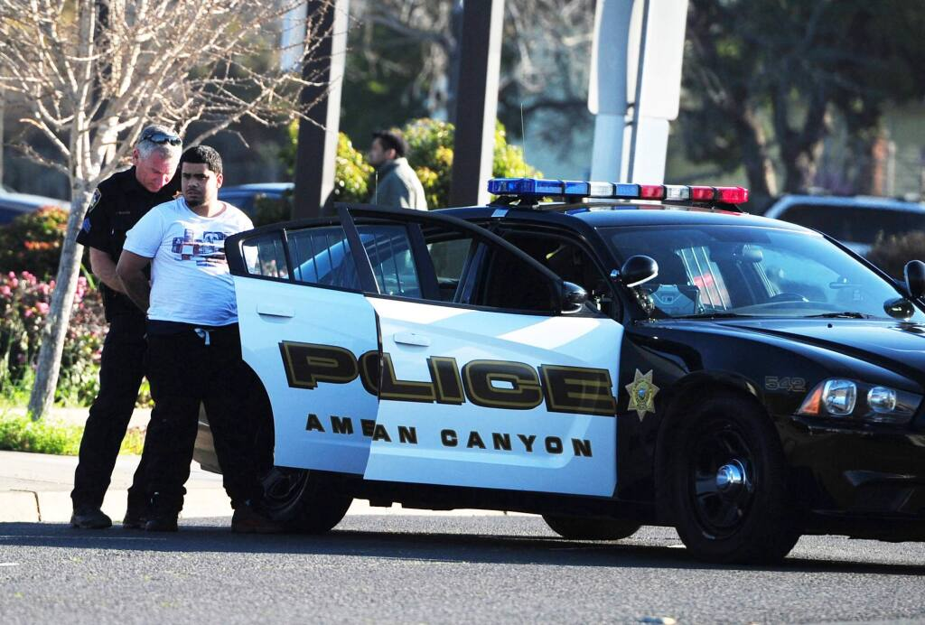 One of five suspects allegedly involved in two home invasions and a fatal shooting is arrested after a crash on Redwood Street in Vallejo on Thursday, Feb. 8, 2018. (CHRIS RILEY - Times-Herald)