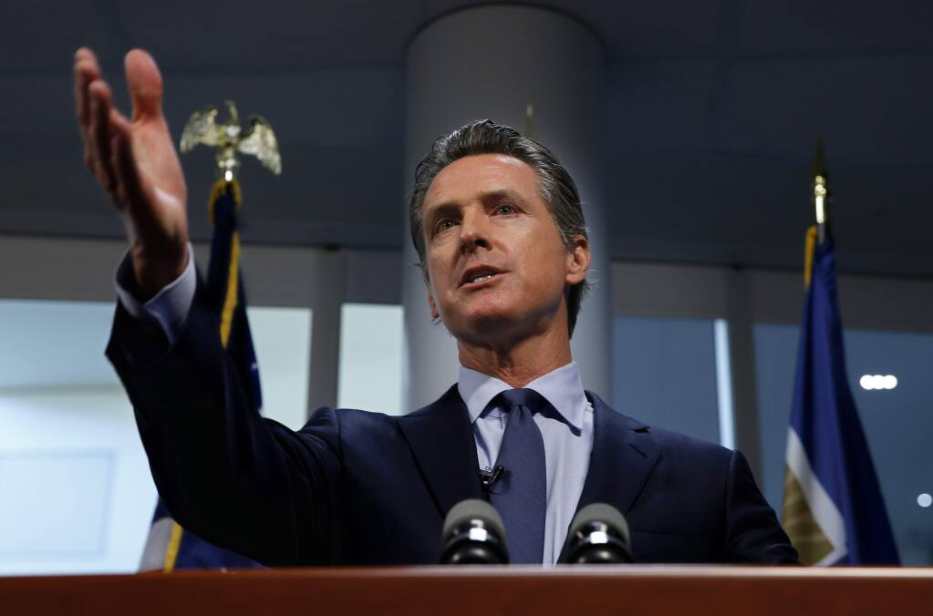 Gov. Gavin Newsom answers a question about a report he presented about the worsening wildfires in the state, during a news conference Friday, April 12, 2019, in Rancho Cordova, Calif. California could create its own power purchasing entity, change the standards that make utilities responsible for damages from wildfires and discourage new housing in areas at high risk of wildfire. Those are among the recommendations in a report Gov. Gavin Newsom presented Friday aimed at addressing a host of problems related to wildfires, chief among them how to maintain a safe, affordable electricity supply for California amid worsening fires. (AP Photo/Rich Pedroncelli)