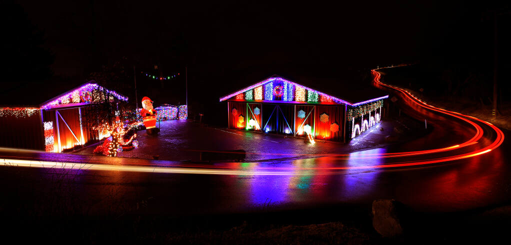 On Riebli Road in the Mark West area east of Santa Rosa, rebuilt barns razed during the Tubbs fire in 2017 owned by Russ Messana are outfitted with lights timed to synch with Christmas music, Friday, Dec. 11, 2020.  (Kent Porter / The Press Democrat) 2020