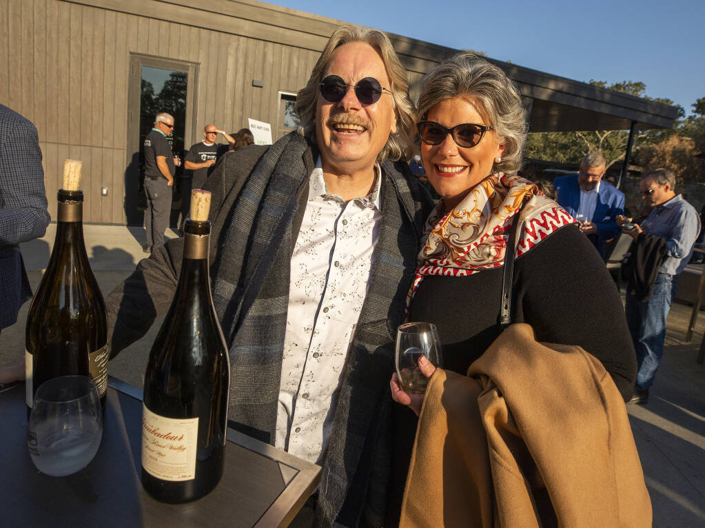 Bob and Heather Cabral poured their Bob Cabral wines for lucky guests at the 2021 Sonoma County Wine Auction weekend kick-off party at Montage Healdsburg on Thursday, Sept. 16, 2021. (John Burgess/The Press Democrat)