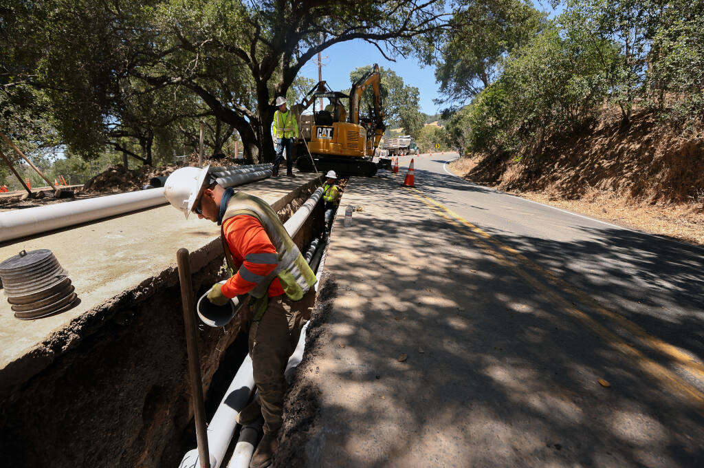 George Hosegera works on a PG&E project to move power lines underground along Calistoga Road, near Harville Road, in Santa Rosa on Monday, June 28, 2021.  PG&E is placing power lines underground in the area to help prevent customers from being impacted by Public Safety Power Shutoffs during severe weather conditions.  (Christopher Chung / The Press Democrat)