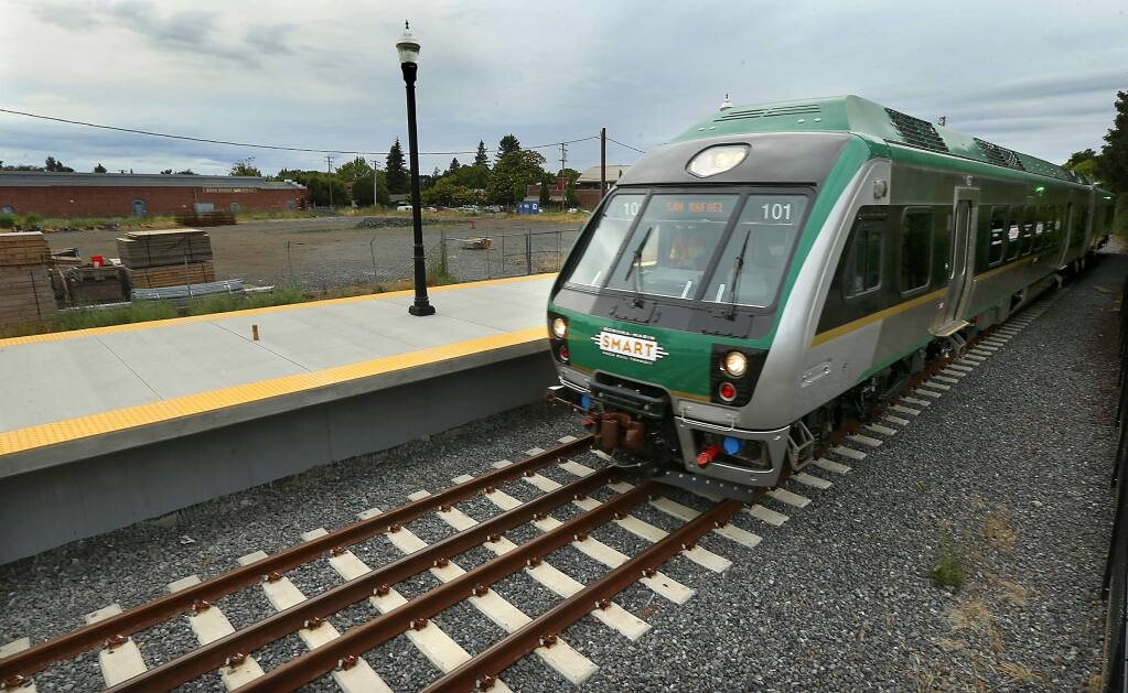 Passenger trains will begin rolling through the Railroad Square station in Santa Rosa by the end of the year, but plans for a live/work development on the lot west of the station. upper left, remain unfulfilled . (JOHN BURGESS/The Press Democrat)