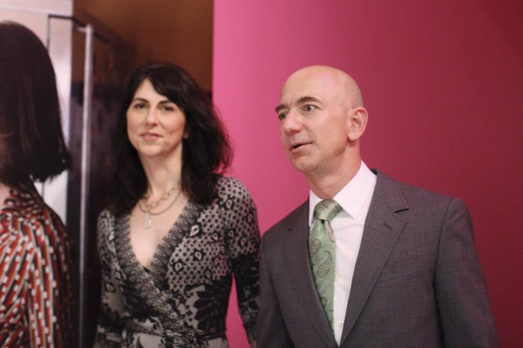 Jeff Bezos, the founder of Amazon.com, with his wife, MacKenzie Bezos at the opening party for Diane Von Furstenberg's exhibition 'Journey of a Dress' at the Wilshire May Company Building in Los Angeles, Jan. 10, 2014. The celebration marked the 40th birthday of Von Furstenberg's emblematic wrap dress. (Emily Berl/The New York Times)