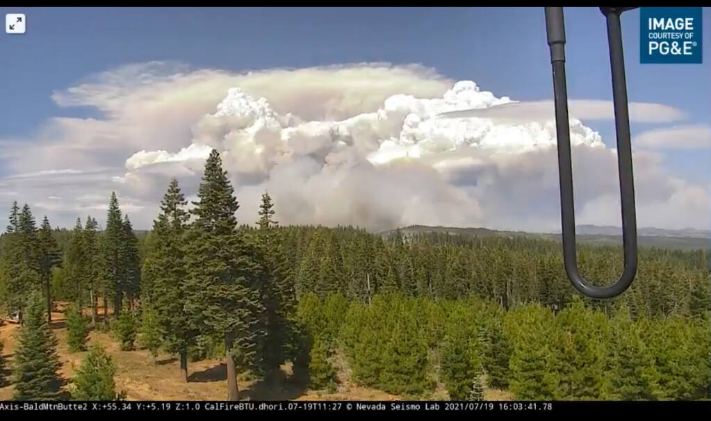 A screenshot from a video that the National Weather Service-Sacramento shared to Twitter shows pyro cumulonimbus clouds forming above the Dixie fire Monday, July 19, 2021.