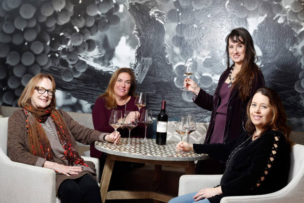 Wine Women co-founders, from left, Christine Mueller, Ellen Reich-Luchtel, Marcia Macomber, and Jackie Egidio at the Passagio Wines tasting room, in Sonoma, California, on Thursday, April 19, 2018. (Alvin Jornada / The Press Democrat)