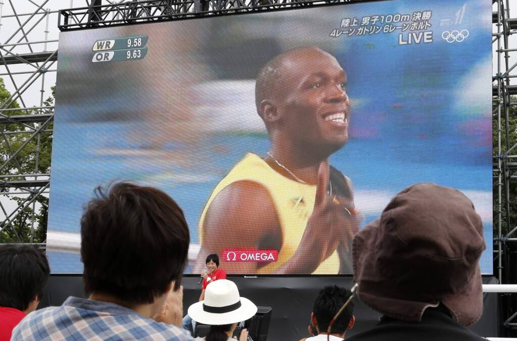 Jamaica's Usain Bolt wins 100-meter Olympic gold
