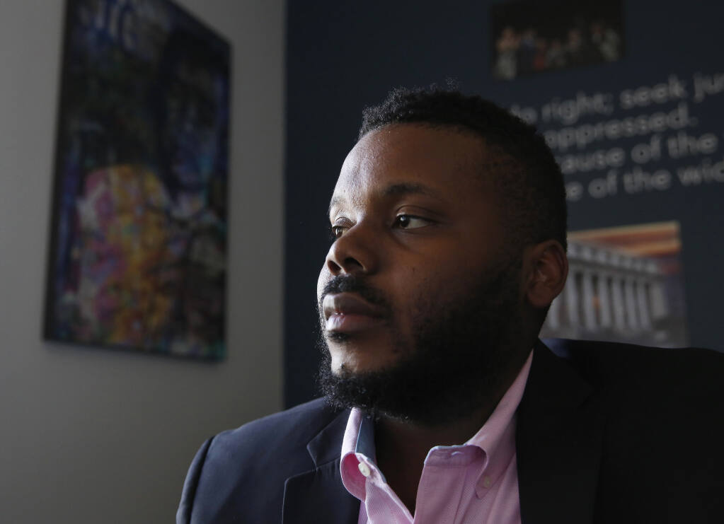 FILE - In this Aug. 14, 2019, file photo, Stockton Mayor Michael Tubbs talks during an interview in Stockton, Calif.  Tubbs is one of the youngest mayors in the country and was the city's first Black mayor. He garnered national attention with his universal basic income program that fights poverty by paying people $500 a month. But despite winning 70% of the vote, Tubbs is trailing a Republican challenger, putting him in danger of losing his seat.   (AP Photo/Rich Pedroncelli, File)