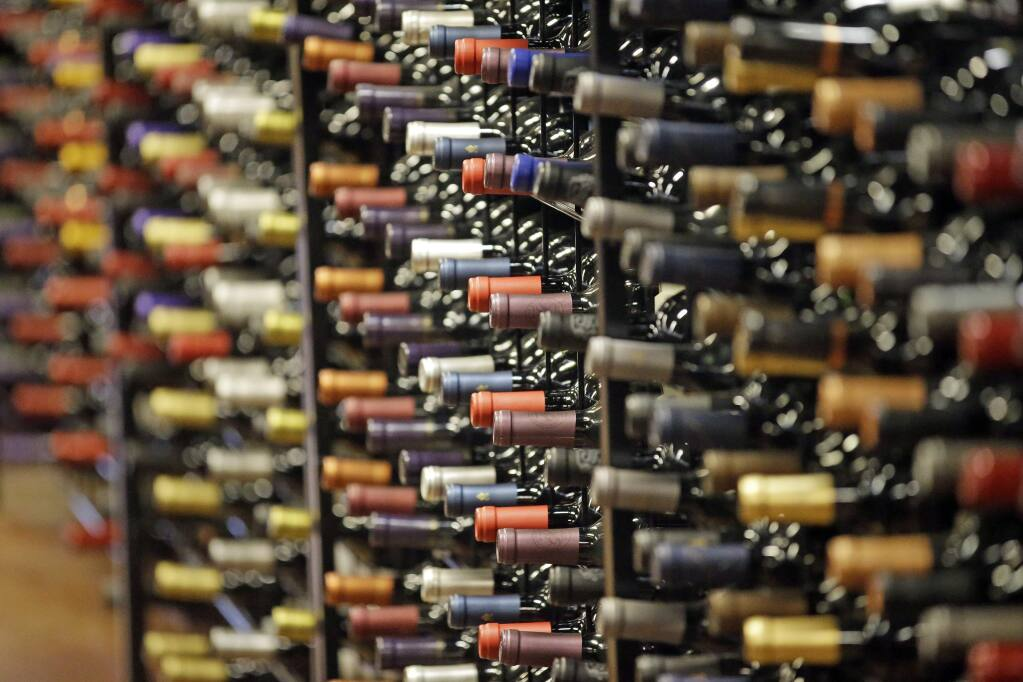 President Donald Trump is threatening to impose a 100% tariff on wine and Champagne imported from the European Union. (RICK BOWMER / Associated Press)