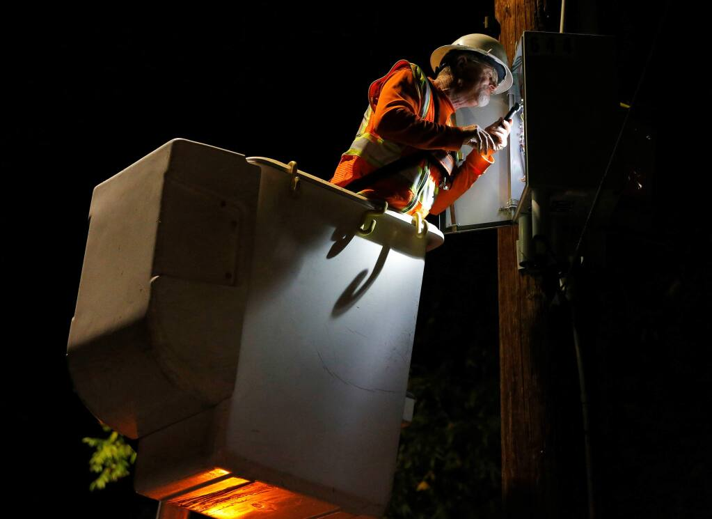 A PG&E crew works to re-energize power lines along Middle Rincon Road after the public safety power shutoff in Santa Rosa on Thursday, Oct. 10, 2019. (Alvin Jornada / The Press Democrat)