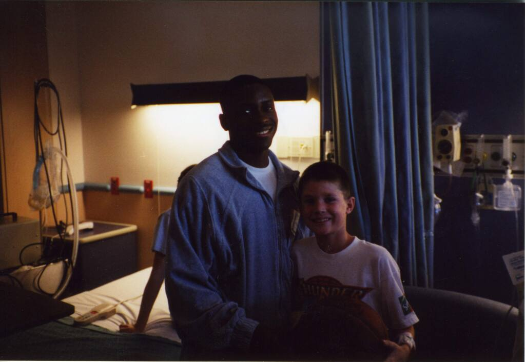 On Jan. 19, almost 17 years to the day from their first meeting (seen above), Earl Boykins walked back into Bobby Sharp's life when Sharp visited a friend in Arkansas, where Boykins is a Razorbacks assistant coach. Sharp made sure he didn't miss his chance to tell Boykins what the former NBA player's visit 17 years ago meant to him. (Sharp family)