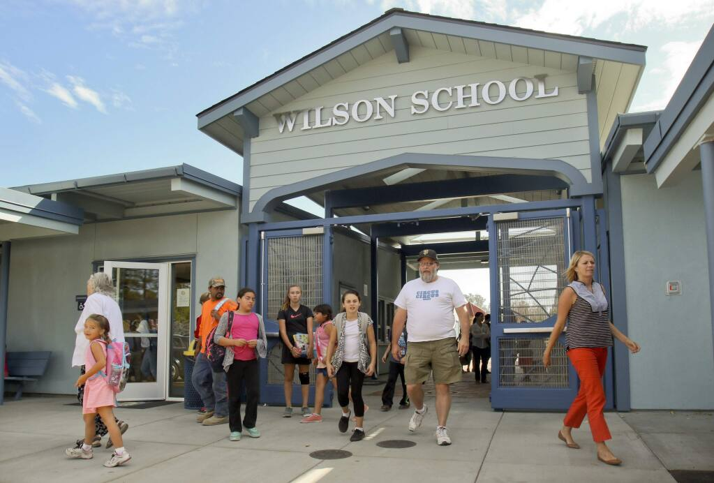 Students and parents flow through the new gateway at Wilson School Petaluma as they go home after school on Monday, September 28, 2015. (SCOTT MANCHESTER/ARGUS-COURIER STAFF)