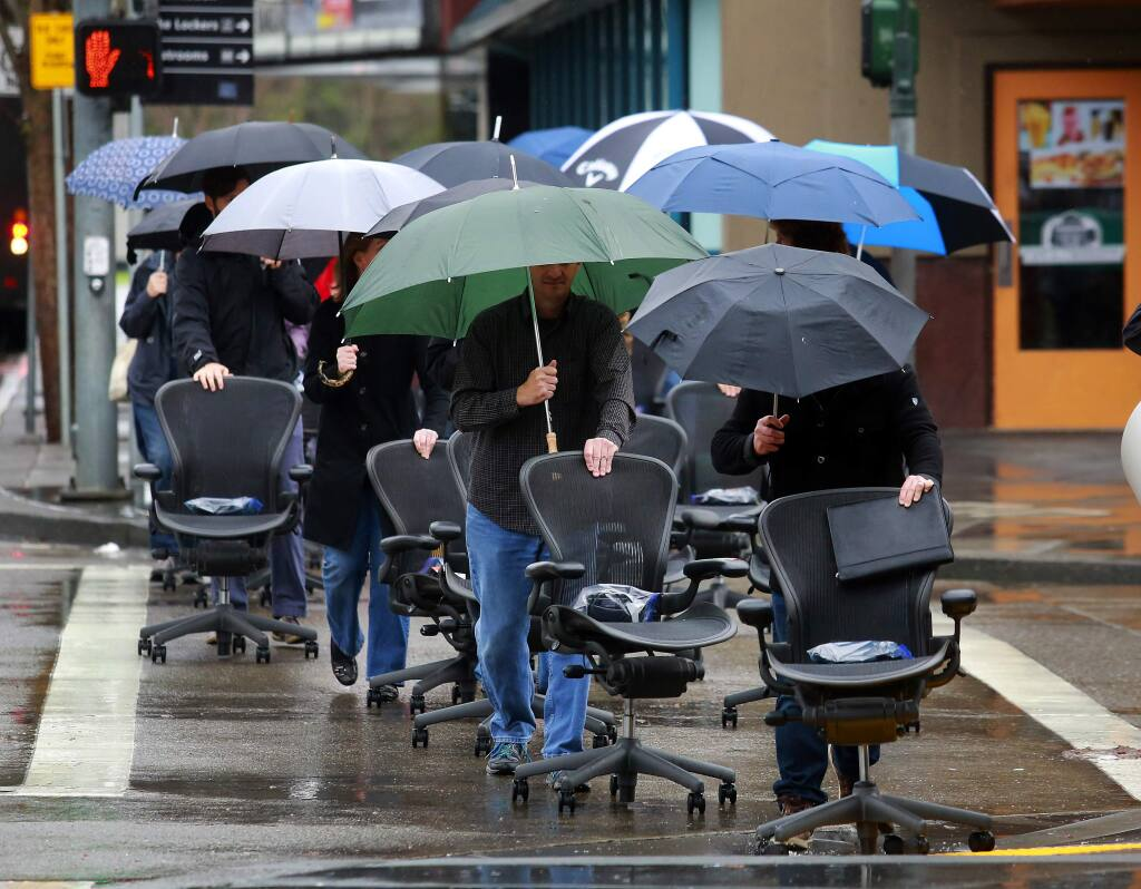 Employees of TLCD Architecture paraded their office chairs and plants from their old offices on Santa Rosa Ave to the 2nd floor of the Museum on the Square building in downtown Santa Rosa. (JOHN BURGESS / The Press Democrat)