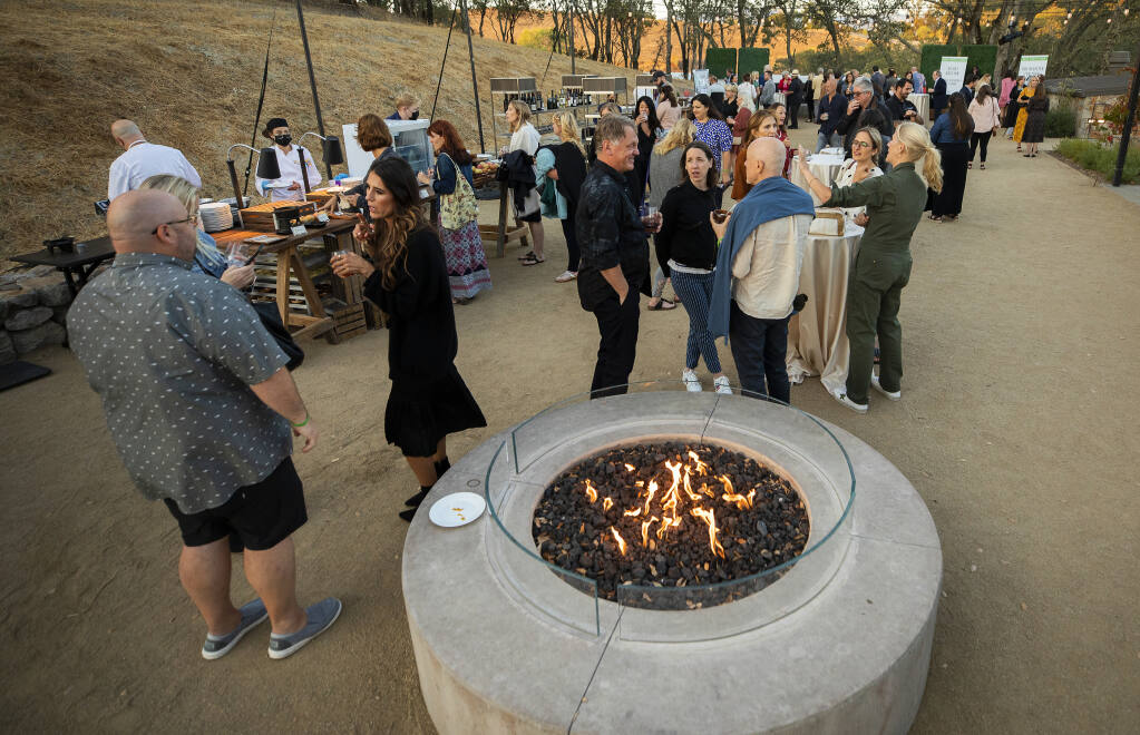 Guests headed up to an upper terrace for more food, wine and a look at auction items at the 2021 Sonoma County Wine Auction weekend kick off party at Montage Healdsburg on Thursday, Sept. 16, 2021. (John Burgess/The Press Democrat)