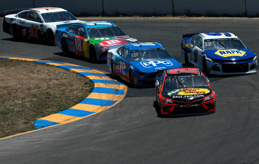 SONOMA, CALIFORNIA - JUNE 23: Martin Truex Jr., driver of the #19 Bass Pro Shops Toyota, leads a pack of cars during the Monster Energy NASCAR Cup Series Toyota/Save Mart 350 at Sonoma Raceway on June 23, 2019 in Sonoma, California. (Photo by Sean Gardner/Getty Images)