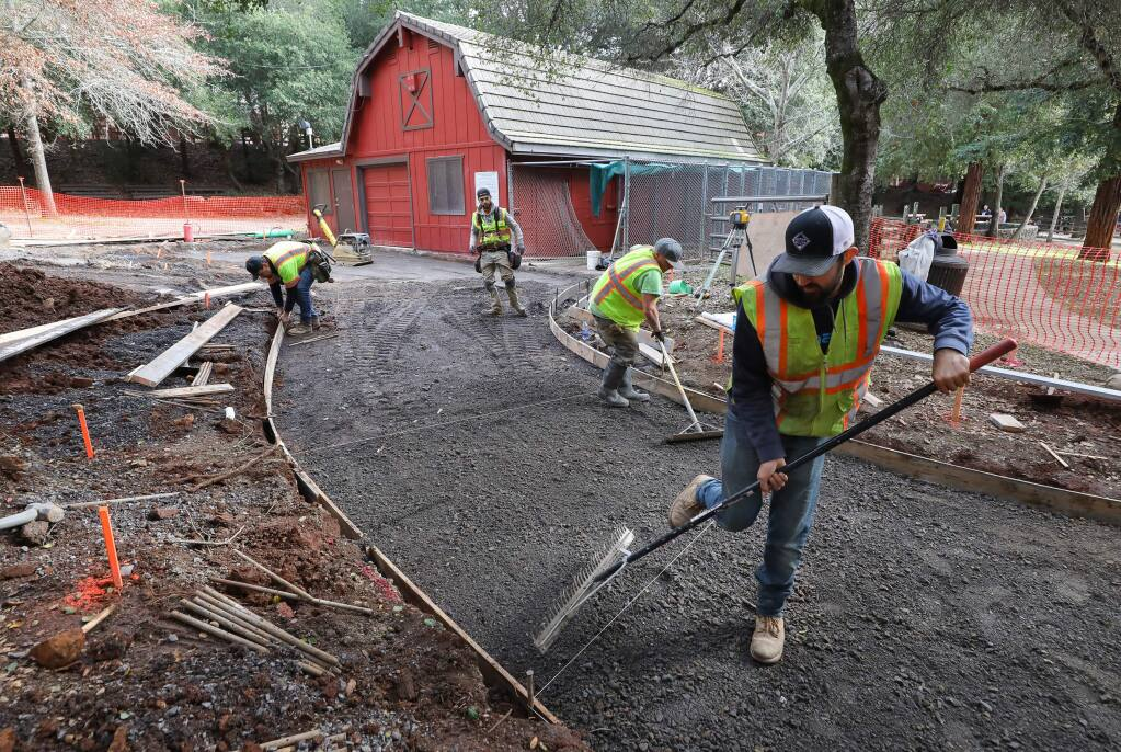 A construction crew works on accessibility alterations to the pathways at Howarth Park in Santa Rosa on Monday, January 13, 2020. (Christopher Chung/ The Press Democrat)