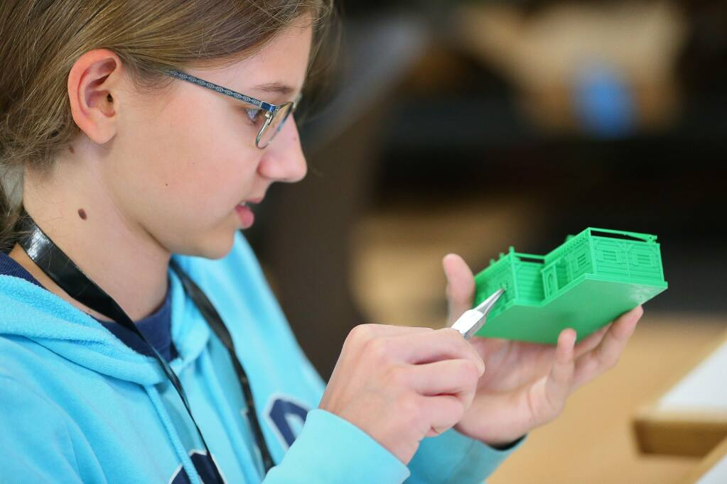 Aliyah Smith, 13, works on a 3D printed model house for an arena she is building for robots during the Girls Tinker Academy at Sonoma State University, in Rohnert Park on Tuesday, July 30, 2019. (Christopher Chung/ The Press Democrat)