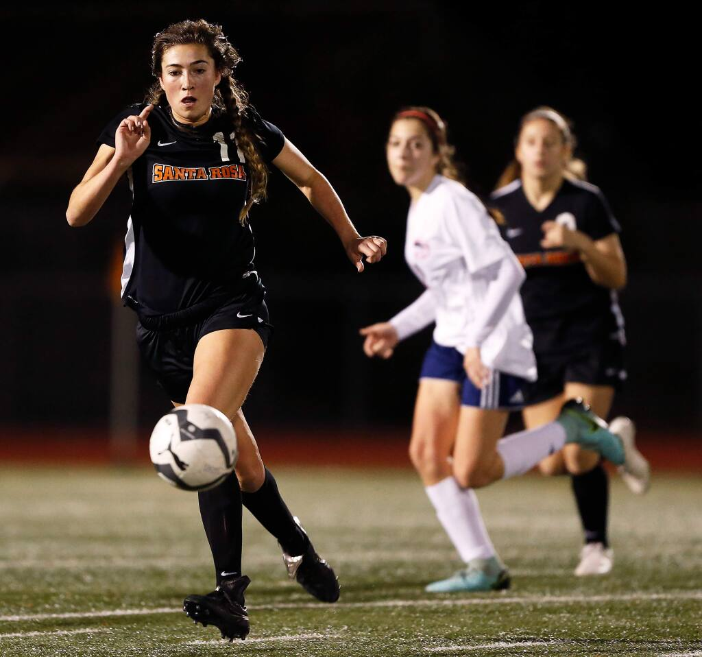 Santa Rosa's Anika Williams, left, dribbles the ball across midfield during the first half of a soccer game between Rancho Cotate and Santa Rosa high schools in Santa Rosa on Tuesday, January 22, 2019. (Alvin Jornada / The Press Democrat)