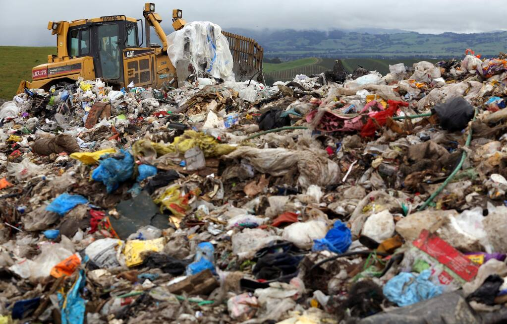 A bulldozer arranges garbage for a compactor at the Sonoma County landfill off Mecham Road. (CHRISTOPHER CHUNG/ PD FILE, 2013)
