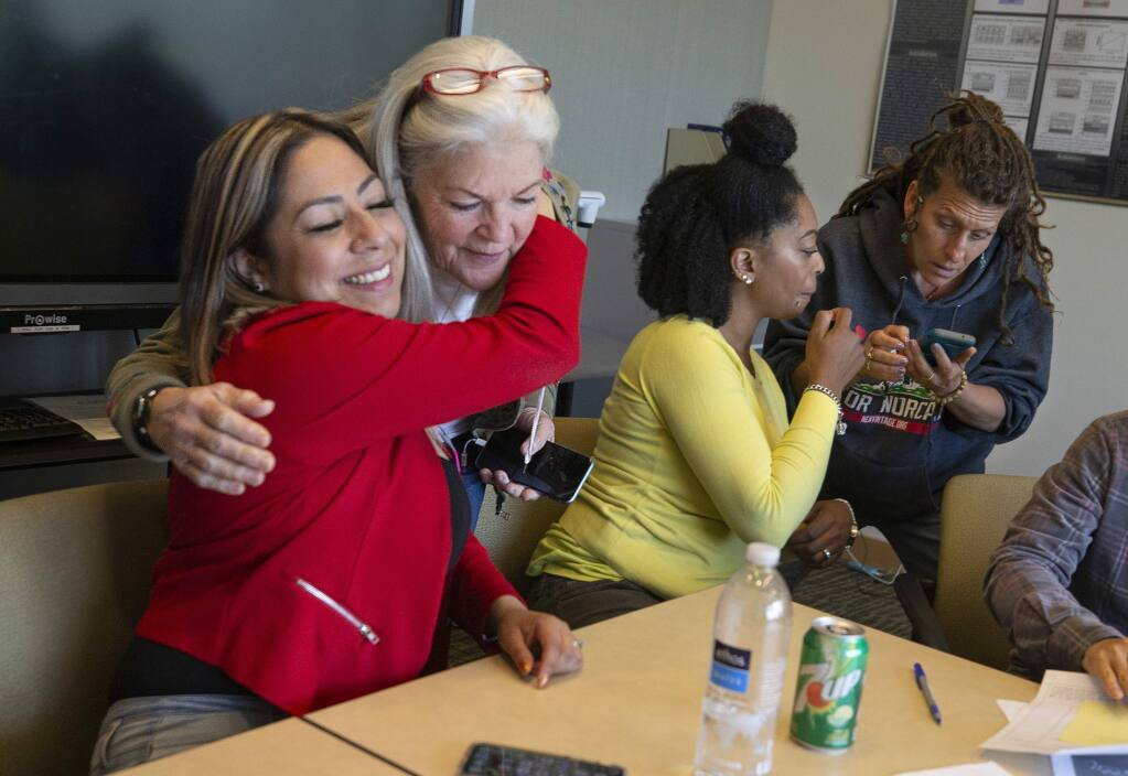 From left, Elizabeth Quiroz, the president of the Second Chance Club, hugs Kate Fielding at the end of their weekly meeting while Constance Tanner and Lisa Aldana exchange information at the end of the weekly meeting o formerly incarcerated Santa Rosa Junior College students. (photo by John Burgess/The Press Democrat)