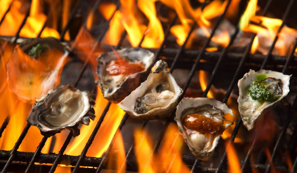 From left, grilled oysters with pesto butter, Louisiana hots and garlic butter served at Rocker Oysterfeller's Kitchen + Saloon in Valley Ford. (JOHN BURGESS/PD)