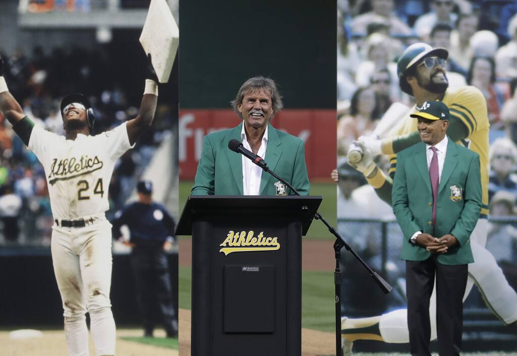 Former pitcher Dennis Eckersley, center, speaks during a ceremony inducting him into the Oakland Athletics' Hall of Fame before a baseball game between the Athletics and the New York Yankees in Oakland, Calif., Wednesday, Sept. 5, 2018. At right is Reggie Jackson. (AP Photo/Jeff Chiu)