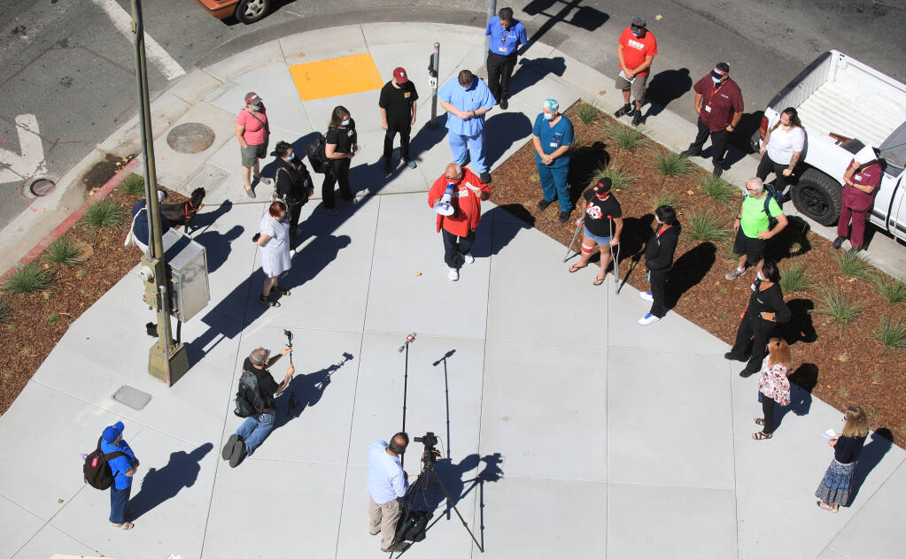 Hospital medical technicians rally across the street from Santa Rosa Memorial Hospital, Wednesday, Sept. 23, 2020 in a call to hospital administration to conduct broader COVID-19 testing and ramp up infection control.  (Kent Porter / The Press Democrat) 2020