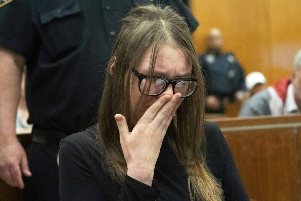 Anna Sorokin cries during sentencing at New York State Supreme Court in New York, Thursday, May 9, 2019. Sorokin, the German con artist who passed herself off as a wealthy heiress to swindle banks, hotels and even close friends, was sentenced Thursday to four to 12 years behind bars. (Steven Hirsch/New York Post via AP, Pool)