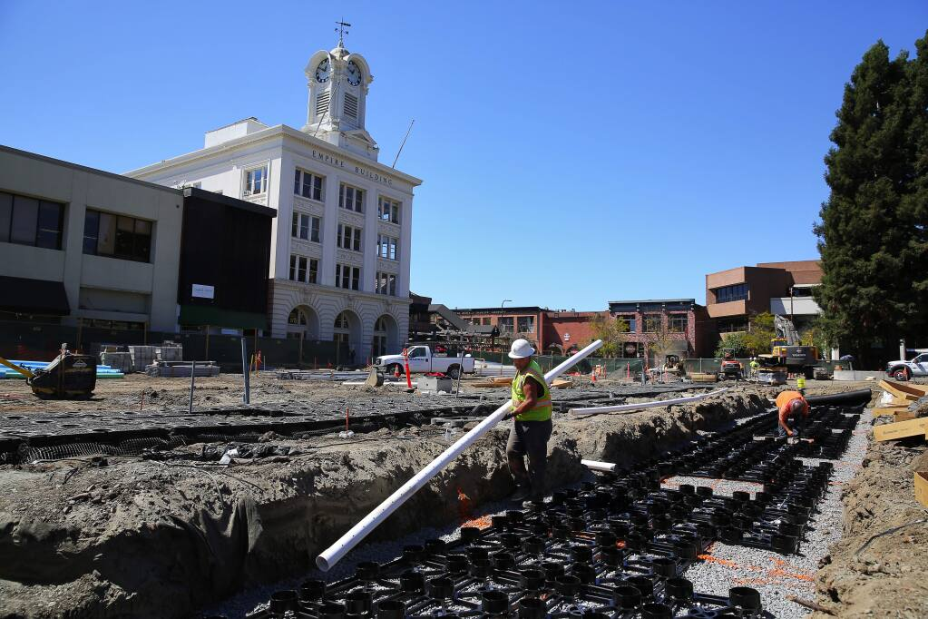 Construction workers install Silva Cells around Courthouse Square in Santa Rosa, on Wednesday, Aug. 31, 2016. The cells use soil volumes to support large tree growth and provide stormwater management. (Christopher Chung / The Press Democrat)