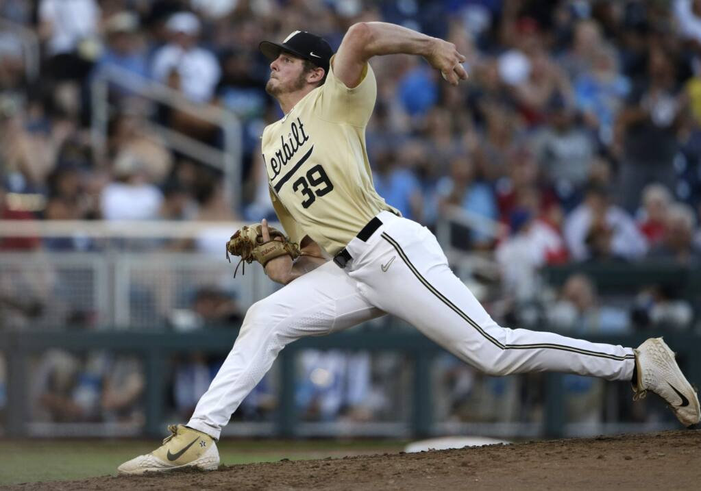 Vanderbilt's Jake Eder prepares to throw against Michigan during the seventh inning in Game 3 of the NCAA College World Series in Omaha, Neb., Wednesday, June 26, 2019. (AP Photo/Nati Harnik)