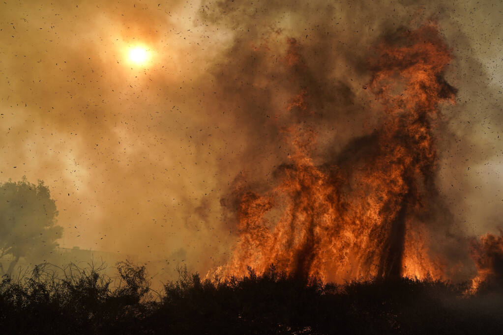 A group of scientists from universities, government and private industry is developing new tools for predicting the behavior of wildfires. (JAE C. HONG / Associated Press, 2020)