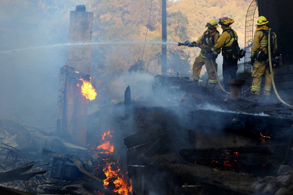 Monterey firefighters work to put out a fire at 11640 Hwy. 128 east of Chalk Hill Road during the Kincade fire near Calistoga on Tuesday, Oct. 29, 2019. (BETH SCHLANKER/ PD)