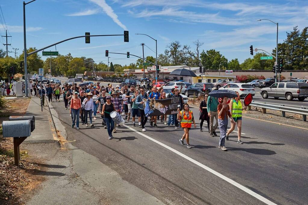 Bay Area-based animal rights group Direct Action Everywhere staged its second such event in the county in the past three months when participants walked from Petaluma's Liberty Cemetery to Petaluma Farms on Cavanaugh Lane on Sunday, July 29, 2018. Photos courtesy Michael Goldberg.