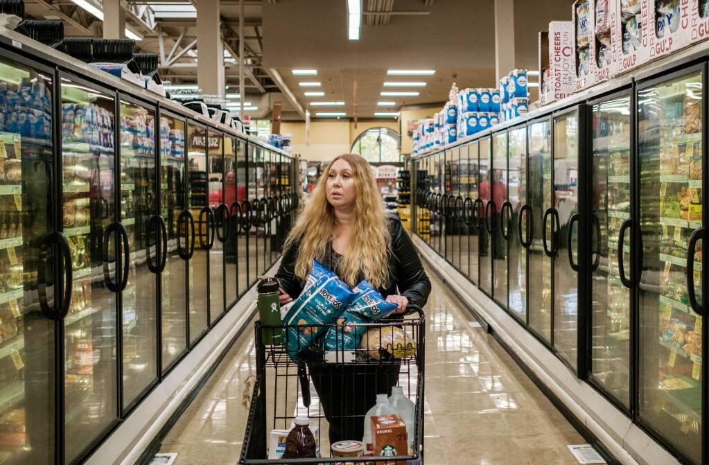 Instacart shopper Vanessa Bain shops for a customer at a Safeway in Menlo Park, California, on Nov. 14, 2019. (Nick Otto/The Washington Post)