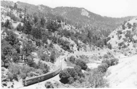 Mike PechnerA passenger train winds its way through Eel River Canyon.