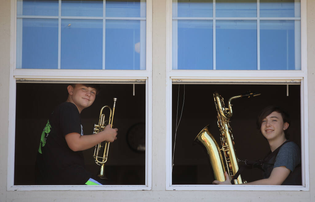 Casey, 11, and Cody Peters, 15, at their home in Windsor. The two music students have benefited from Rincon Valley's standout music program, but cuts to the comprehensive music program will affect Casey and others in the school district, Friday, July 17, 2020. (Kent Porter / The Press Democrat) 2020