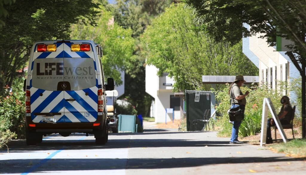 At Sonoma State University in Rohnert Park, Wednesday, July 8, 2020, transport units are staged near the quarantine zone.  (Kent Porter / The Press Democrat) 2020