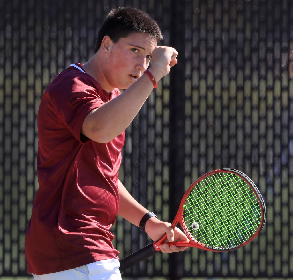 Cardinal Newman's Joe Greco celebrates a winner during his match with Cadell Traya of Maria Carrillo on Tuesday, April 9, 2019 at Cardinal Newman High School in Santa Rosa. (Kent Porter / Press Democrat)