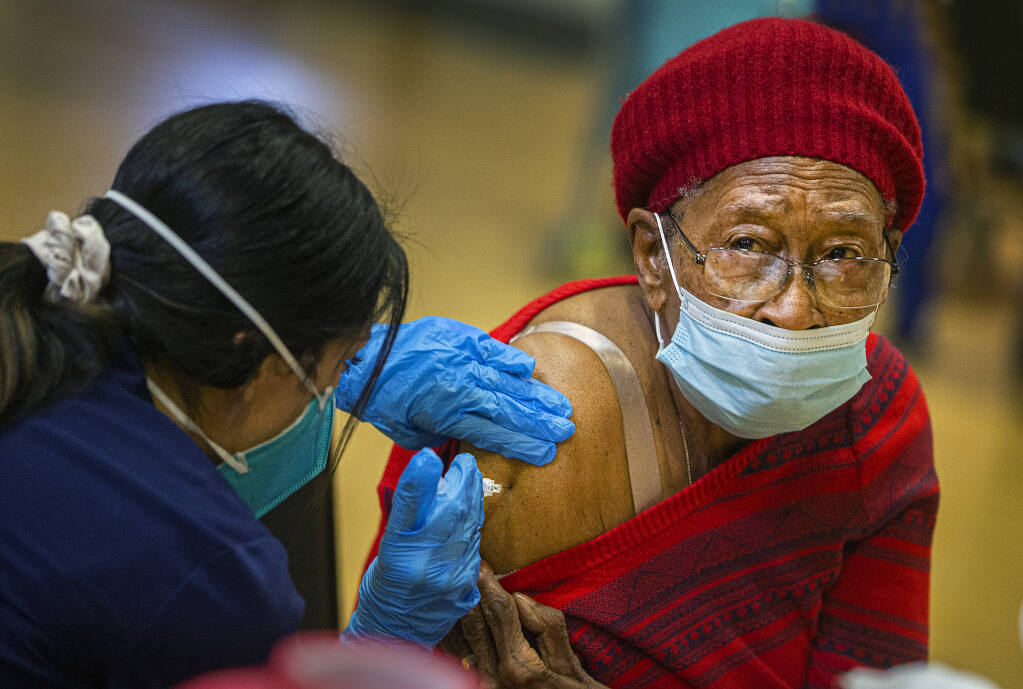 Sammie Williams, 90, receives her first COVID-19 vaccination shot at a clinic for seniors over 75 years old at the Rohnert Park Community Center on Wednesday, January 27, 2021.  (Photo by John Burgess/The Press Democrat)