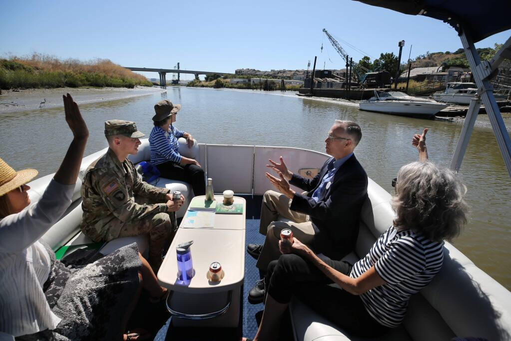 (From right) Elizabeth Howland, Treasurer of Friends of the Petaluma River, US Rep. Jared Huffman, Petaluma Mayor Teresa Barrett, US Army Corps of Engineers Lt. Col. John D. Cunningham, and Jenny Callaway, District Director for Rep. Huffman, tour the Petaluma River in a pontoon boat to discuss dredging and potential solutions to the long term maintenance of the river. Photo taken in Petaluma, California on Friday, August 2, 2019. (BETH SCHLANKER/The Press Democrat)