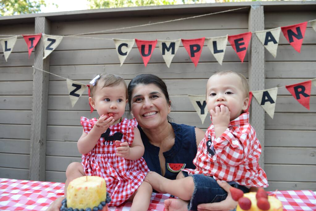 Rosa Lua and her twins, Zara (left) and Zane, on their first birthday celebration in 2016. (Lua family photo)