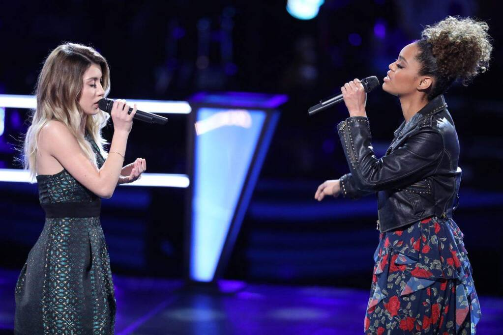 "Dallas Caroline (left) battles Spensha Taylor during the BattleRounds on NBC's ""The Voice."" (Photo: Tyler Golden / NBC)"