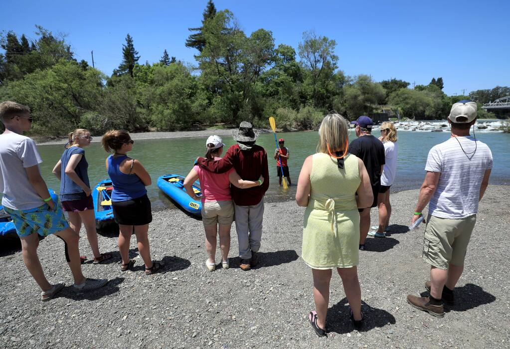 Boaters gather at Russian River Adventures and listen as Angel Martinez gives safety instructions, Thursday, May 30, 2019 in Healdsburg, prior to a an inflatable kayak ride downstream. (Kent Porter / The Press Democrat) 2019