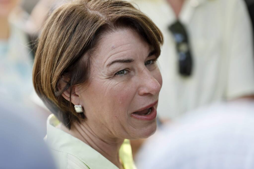 Democratic presidential candidate Sen. Amy Klobuchar speaks to reporters during the Hawkeye Area Labor Council Labor Day Picnic, Monday, Sept. 2, 2019, in Cedar Rapids, Iowa. (AP Photo/Charlie Neibergall)