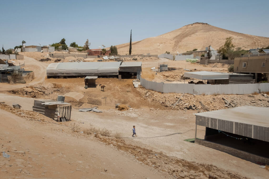 Al Ghara, a Bedouin village in the Negev desert, Israel, on June 6, 2021. For decades, dozens of Bedouin villages in the Negev have been in limbo. Without the stateÕs recognition of their communities, they have long suffered from a lack of planning and basic services like running water, sewers, electricity, trash collection and paved roads. (Amit Elkayam/The New York Times)
