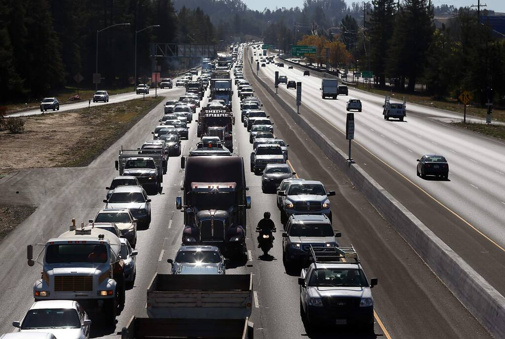 Traffic on northbound Highway 101 is gridlocked, as seen from the Rohnert Park Expressway overpass, due to traffic from the opening of the Graton Resort & Casino in Rohnert Park on Tuesday, November 5, 2013. (Christopher Chung/ The Press Democrat)