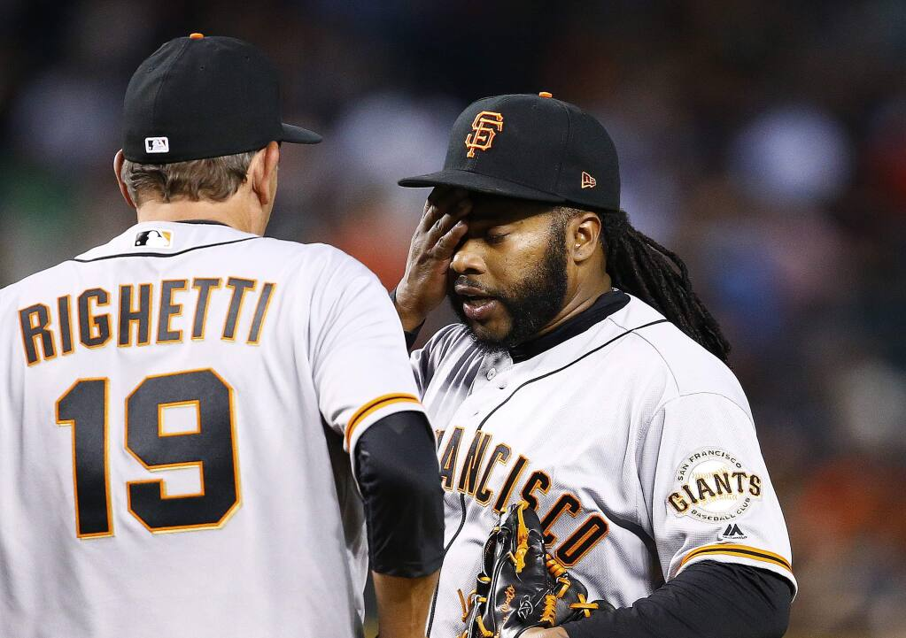 San Francisco Giants pitching coach Dave Righetti (19) visits with pitcher Johnny Cueto, right, during the fourth inning of a baseball game against the Arizona Diamondbacks Tuesday, April 4, 2017, in Phoenix. (AP Photo/Ross D. Franklin)