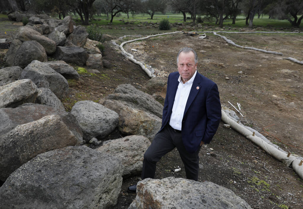 California State Sen. Bill Dodd, D-Napa, representing the 3rd Senate District, stands near the site of condominiums that burned on Tamarack Drive during the Atlas fire in 2017. Photo taken in Napa on Wednesday, January 30, 2019. (BETH SCHLANKER/THE PRESS DEMOCRAT)