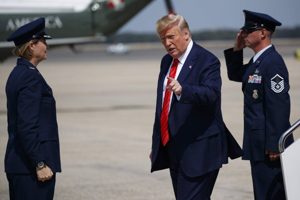 President Donald Trump points to reporters after arriving at Andrews Air Force Base, Thursday, Sept. 26, 2019, in Andrews Air Force Base, Md. (AP Photo/Evan Vucci)